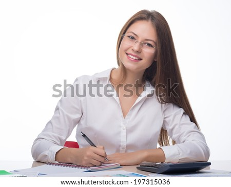 Portrait of a woman writing notes