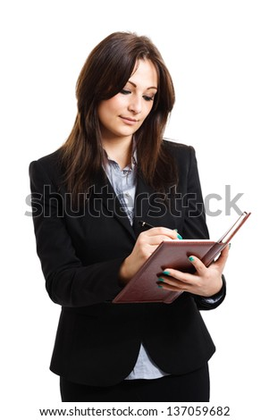 Portrait of a woman writing on a notebook