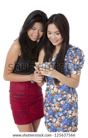 Portrait of a women looking at cellular phone while both smiling - stock photo