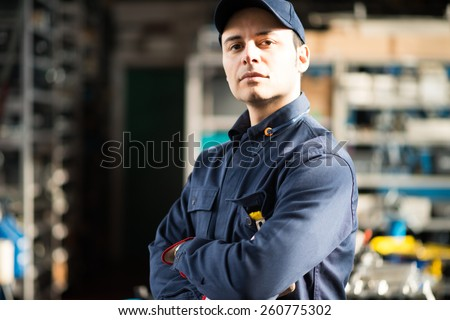 Portrait of a worker in his shop - stock photo
