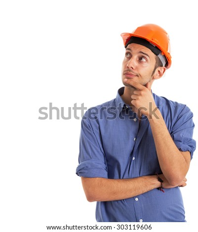 Portrait of a worker looking at the white copy-space - stock photo