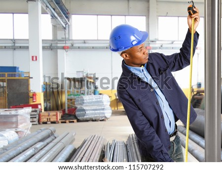 Portrait of a worker using a tape - stock photo