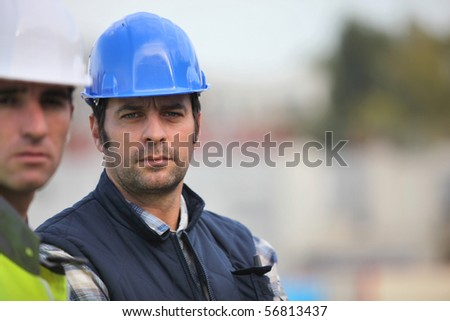 Portrait of a worker with safety helmet - stock photo