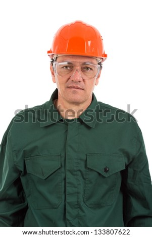 portrait of a workman in overalls and helmet isolated on white background - stock photo