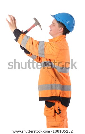 Portrait of a workman wearing overalls and hardhat with hammer - stock photo