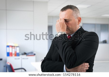 Portrait of a worried and stressed businessman - stock photo