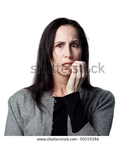 Portrait of a worried older lady, biting her nails - stock photo