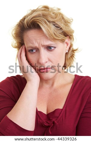 Portrait of a worried woman thinking on isolated background - stock photo