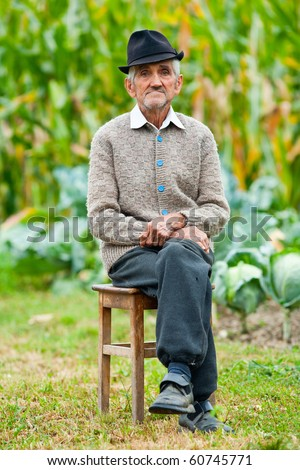 Portrait of a wrinkled and expressive old farmer outdoor - stock photo