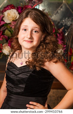 Portrait of a 10 year old girl posing in a castle. - stock photo