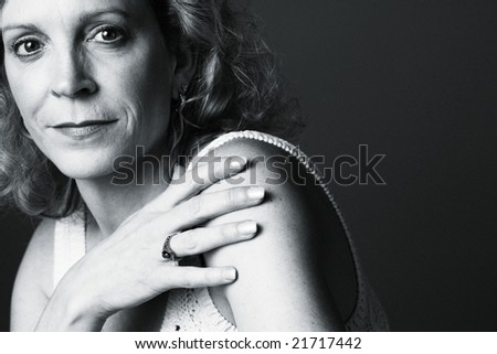 Portrait of a 50 year old woman on a plain background - stock photo