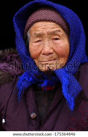 Portrait of a 95 years old woman, born in 1919, the last generation that bind the feet of woman - stock photo