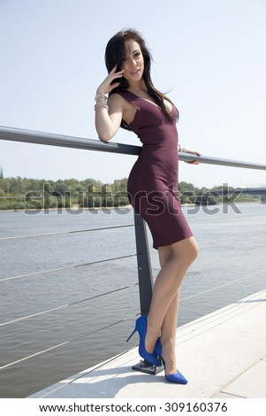 Portrait of a young adult attractive sexy and sensuality pretty beautiful brunette woman on the outdoor city - stock photo