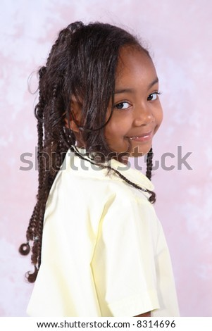 Portrait of a young African American school girl - stock photo