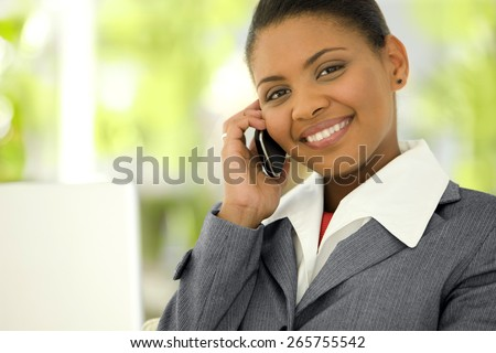Portrait of a young Afro American Businesswoman giving a phone call with smart phone - stock photo