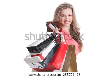Portrait of a young and happy shopping lady on white studio background
