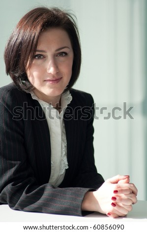 Portrait of a young and pretty businesswoman - stock photo