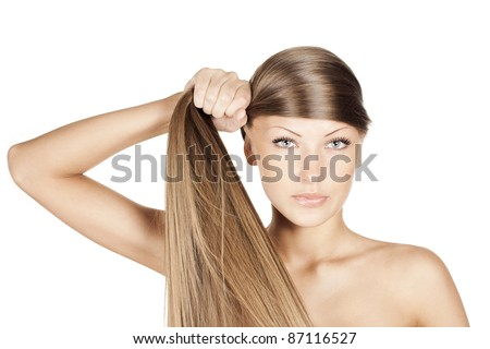 portrait of a young and sexy beautiful woman holding her beautiful natural long hair