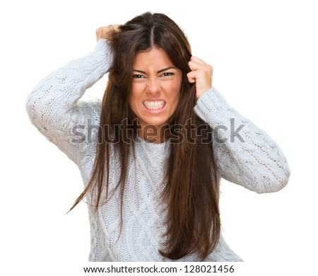 Portrait Of A Young Angry Woman On White Background