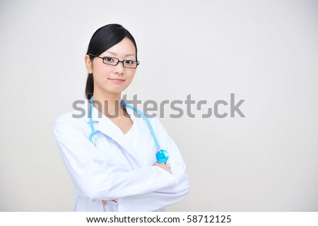Portrait of a young asian doctor - stock photo