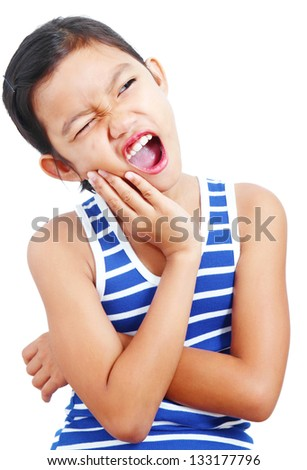 Portrait of a young asian girl with toothache. - stock photo