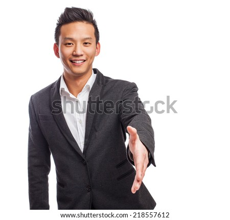 portrait of a young asian man greeting gesture - stock photo