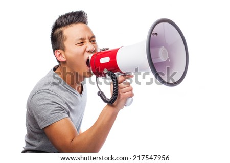 portrait of a young asian man shouting with a megaphone