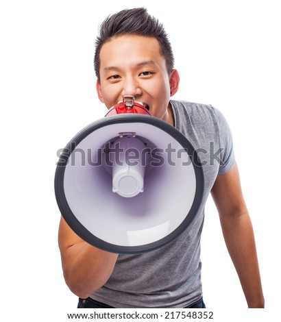 portrait of a young asian man shouting with a megaphone - stock photo