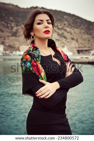 Portrait of a young attractive girl on the waterfront - stock photo