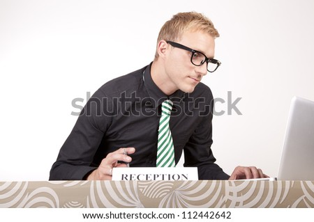 Portrait of a young attractive male receptionist.