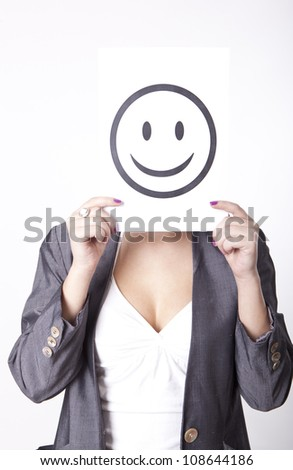 Portrait of a young attractive woman with a sign smile. - stock photo