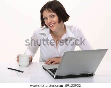 Portrait of a young attractive woman with cup of coffee and laptop