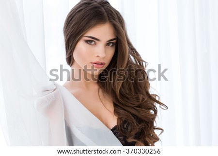 Portrait of a young attractve woman in black bra looking at camera - stock photo
