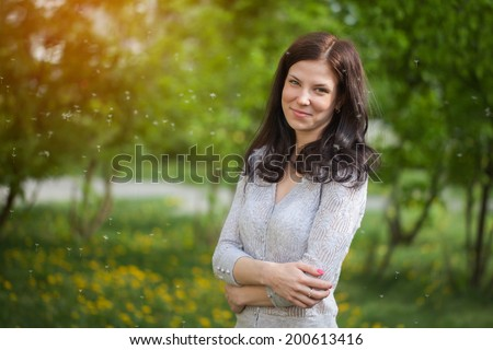 portrait of a young beautiful brunette girl  in a park in spring
