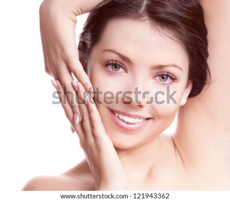 portrait of a young beautiful brunette woman touching her face, isolated on white background - stock photo