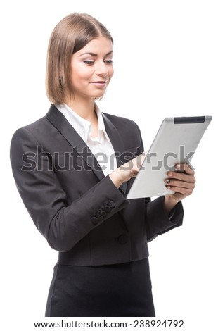Portrait of a young, beautiful business woman using tablet, isolated on a white background. - stock photo