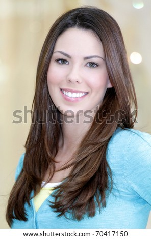 Portrait of a young beautiful Caucasian woman, focus on girl's face