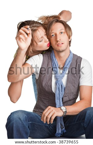 Portrait of a young beautiful couple. Young woman embraces man.