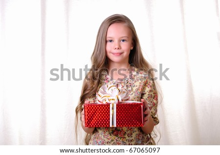 Portrait of a young beautiful girl. A girl receives a gift. - stock photo