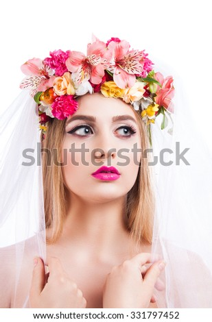 Portrait of a young beautiful girl. bride in veil. Girl with a veil on his face and flowers in her hair