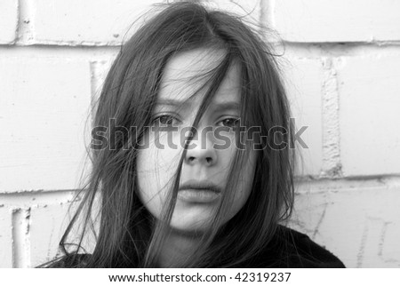 Portrait of a young beautiful girl in despair - stock photo
