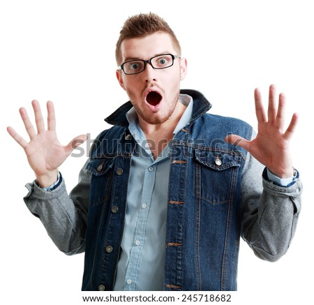 portrait of a young beautiful man in glasses surprised face expression  - stock photo