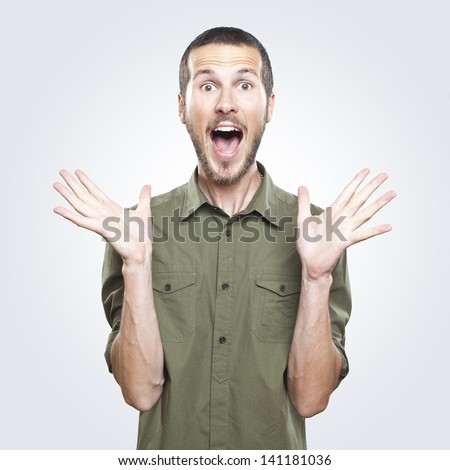 portrait of a young beautiful man surprised face expression - stock photo