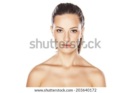 portrait of a young beautiful serious woman - stock photo