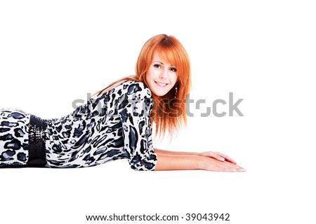 Portrait of a young beautiful smiling girl on the floor in spotted dress. white background - stock photo