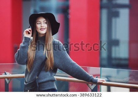 Portrait of a young beautiful smiling woman. Model looking aside.  - stock photo