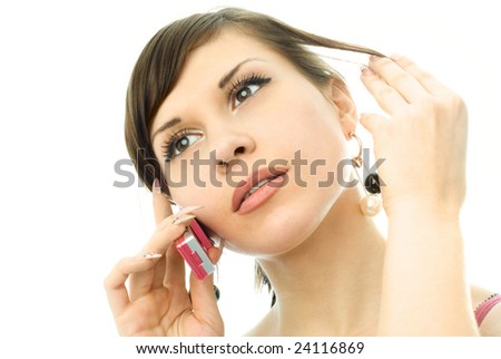portrait of a young beautiful thoughtful woman talking on the cell-phone - stock photo