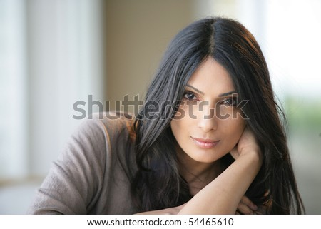 Portrait of a young beautiful woman - stock photo