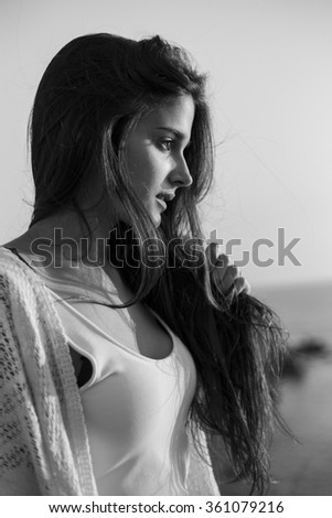 portrait of a young beautiful woman at the sunset