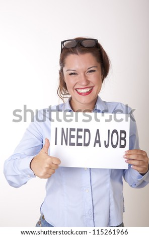 Portrait of a young beautiful woman holding a sign need a job. - stock photo